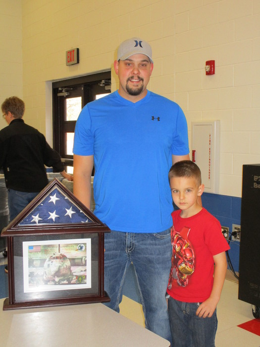 Flown on a AC-130W Stinger ll in honor of Dillman.  Pictured: John Luck-Stepfather and Braden Edwards-accepting flag on behalf of Dillman Elementary