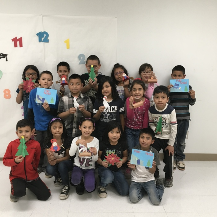 Mrs. Diaz's class showing off their Christmas Around the World crafts.